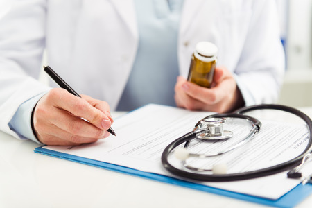 42189919_S_doctor_medication_papers_stethoscope_claims_medical_desk_office_health_advice_prescription.jpg