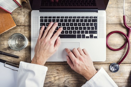 37329449_S_doctor_coat_white_computer_stethoscope_keyboard_type_water_glass.jpg