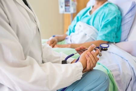 33824120_S_hospital_doctor_patient_surgery_recovery_bed.jpg