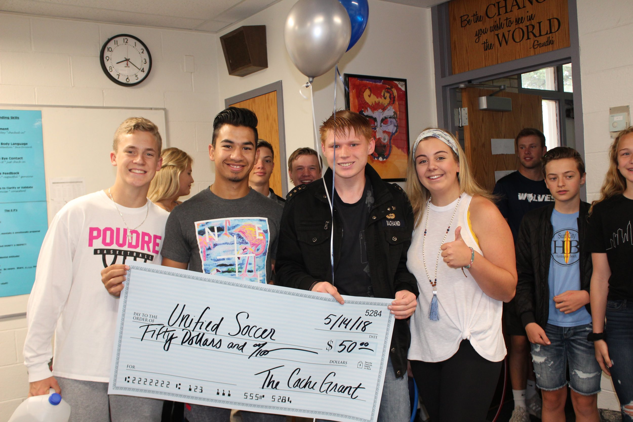 Unified Soccer - Andre, Unified Soccer player, was awarded funds to help cover the cost of athletic fees and to help with the purchase of a new soccer ball.