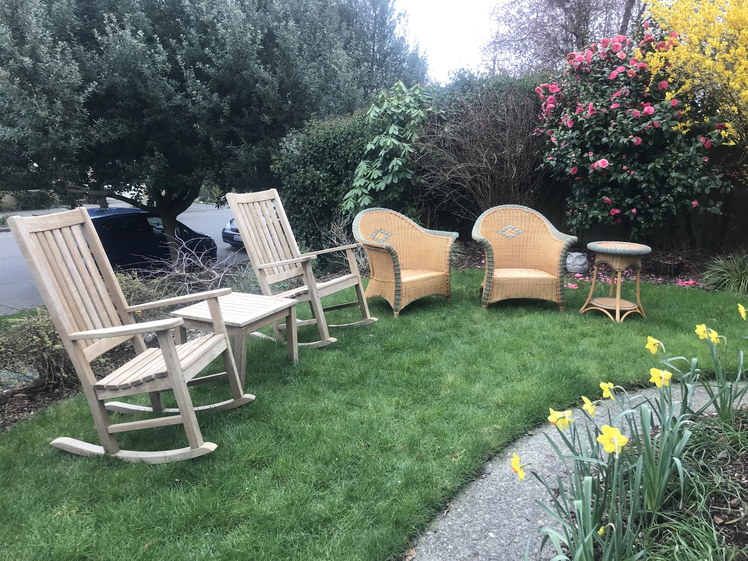 The wicker and teak furniture before, and that ghastly path again.