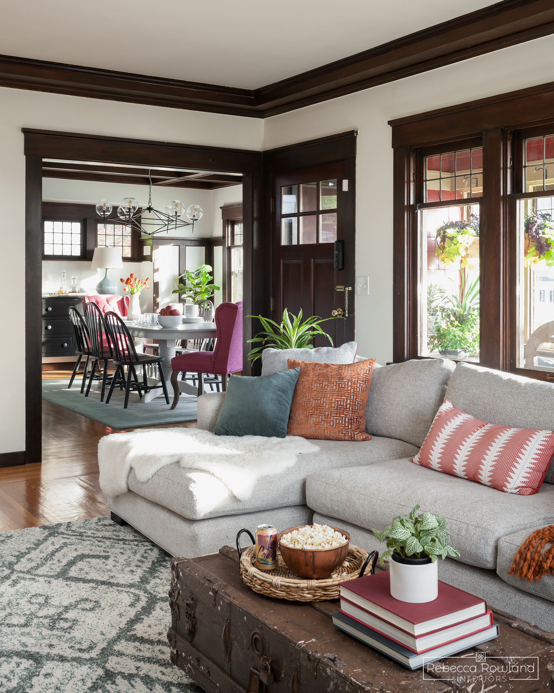 The Roosevelt Craftsman Living Room Reveal. Design by Rebecca Rowland Interiors. Photograph by Julie Mannell. Peekaboo view of the dining room project.