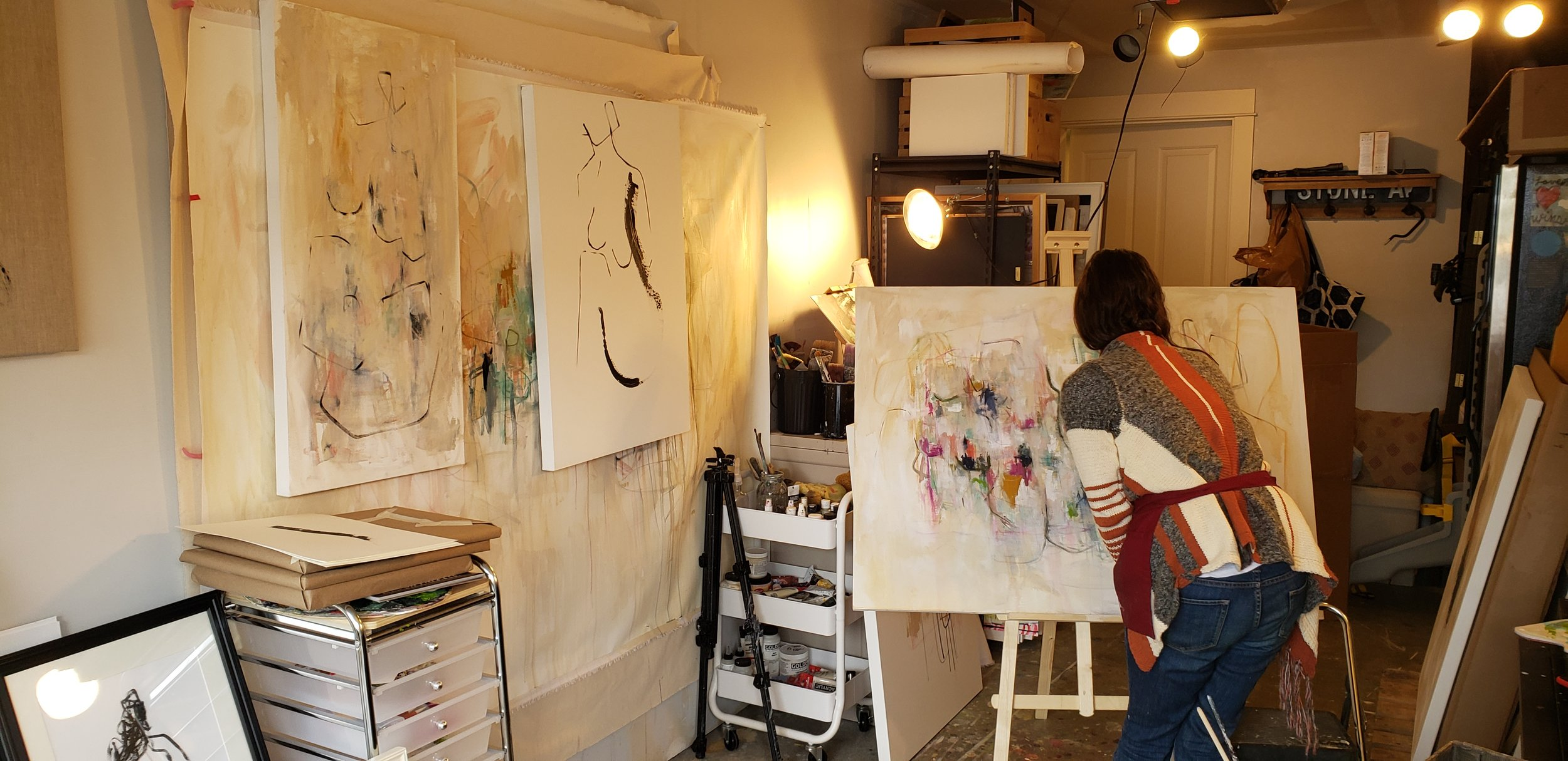 Amy Stone, Seattle Artist, working in her studio. Photo by Puddle & Rain