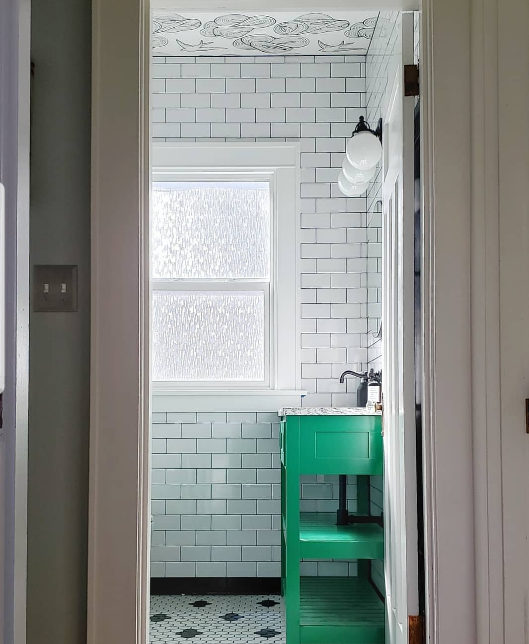 Seattle Bathroom Remodel  - Designed with classic elements like floor to ceiling subway tile, the wallpapered ceiling and pop of color on the custom vanity keep things fresh. A custom 5' medicine cabinet provide power and storage for items like an electric toothbrush.   Status  - Complete; pro photos coming soon   Completion  - Early 2019