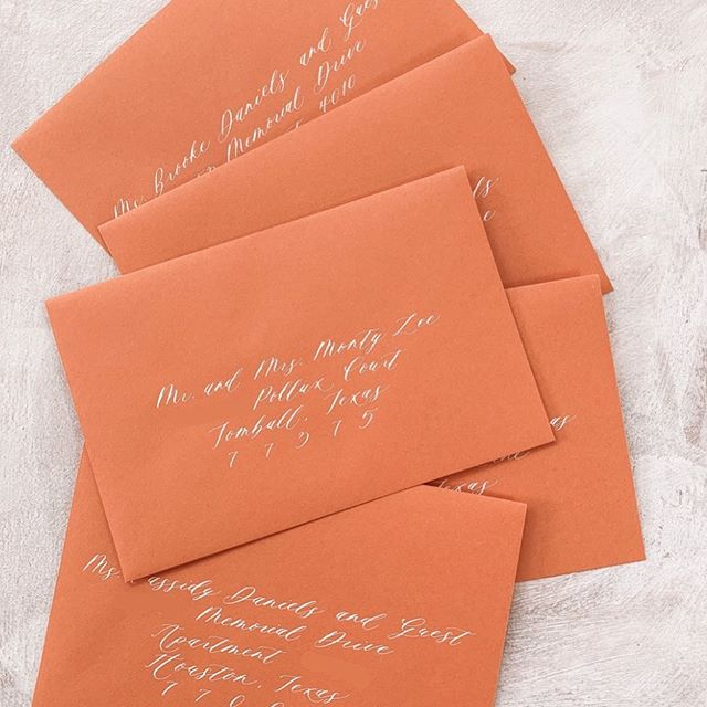 Calligraphy a la carte! One of my favorite services I offer. Did you know you can hire me for calligraphy even if another stationer designed your invitations? • #moderncalligraphy #calligraphy #nolacalligrapher #neworleanscalligrapher #orange #calligraphedenvelope #weddingsuite #rehearsaldinnerinvitations