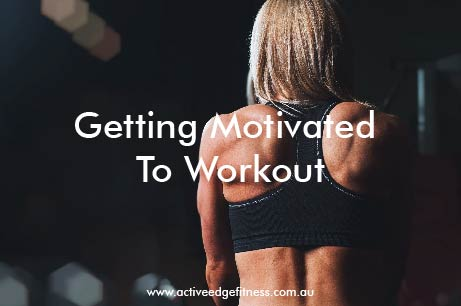 """Fit woman with defined back preparing to workout with caption """"getting motivated to workout"""""""