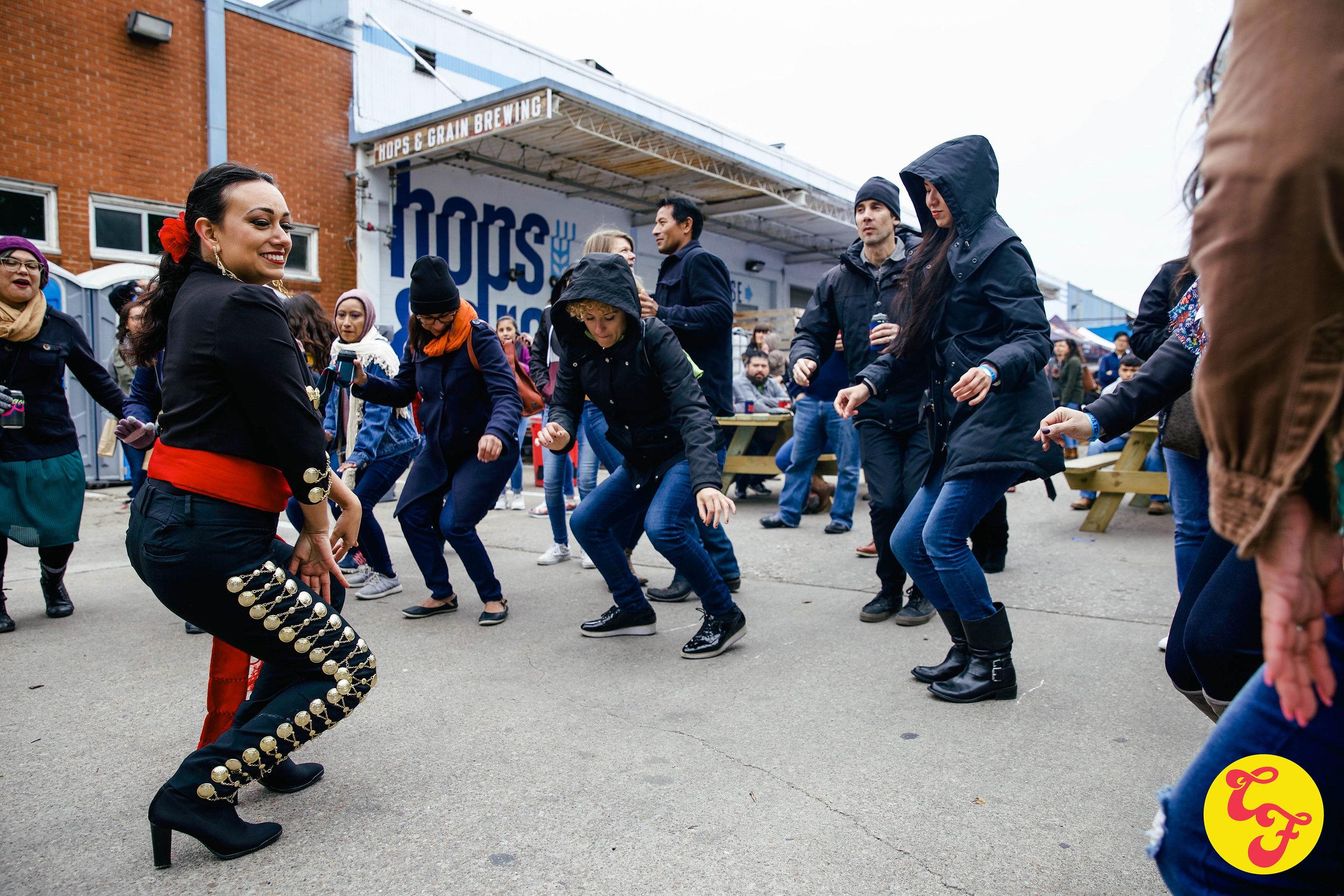 Mariachi Las Coronelas dances with the public.jpg