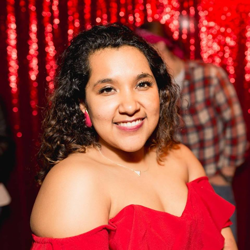 Linzy Beltran, first generation daughter of immigrant parents who escaped the Salvadoran Civil War of the 1980s. She is co-founder of the comedy collective  Glam Fam .