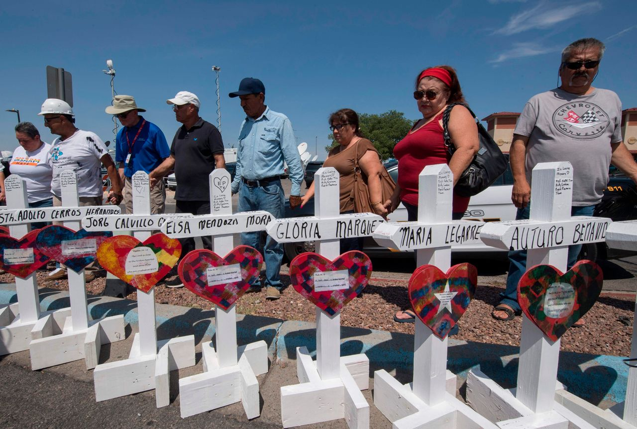 El Paso's community members praying for the victims of Saturday morning's shooting. Photography by Mark Ralston/Agence France-Presse/Getty Images