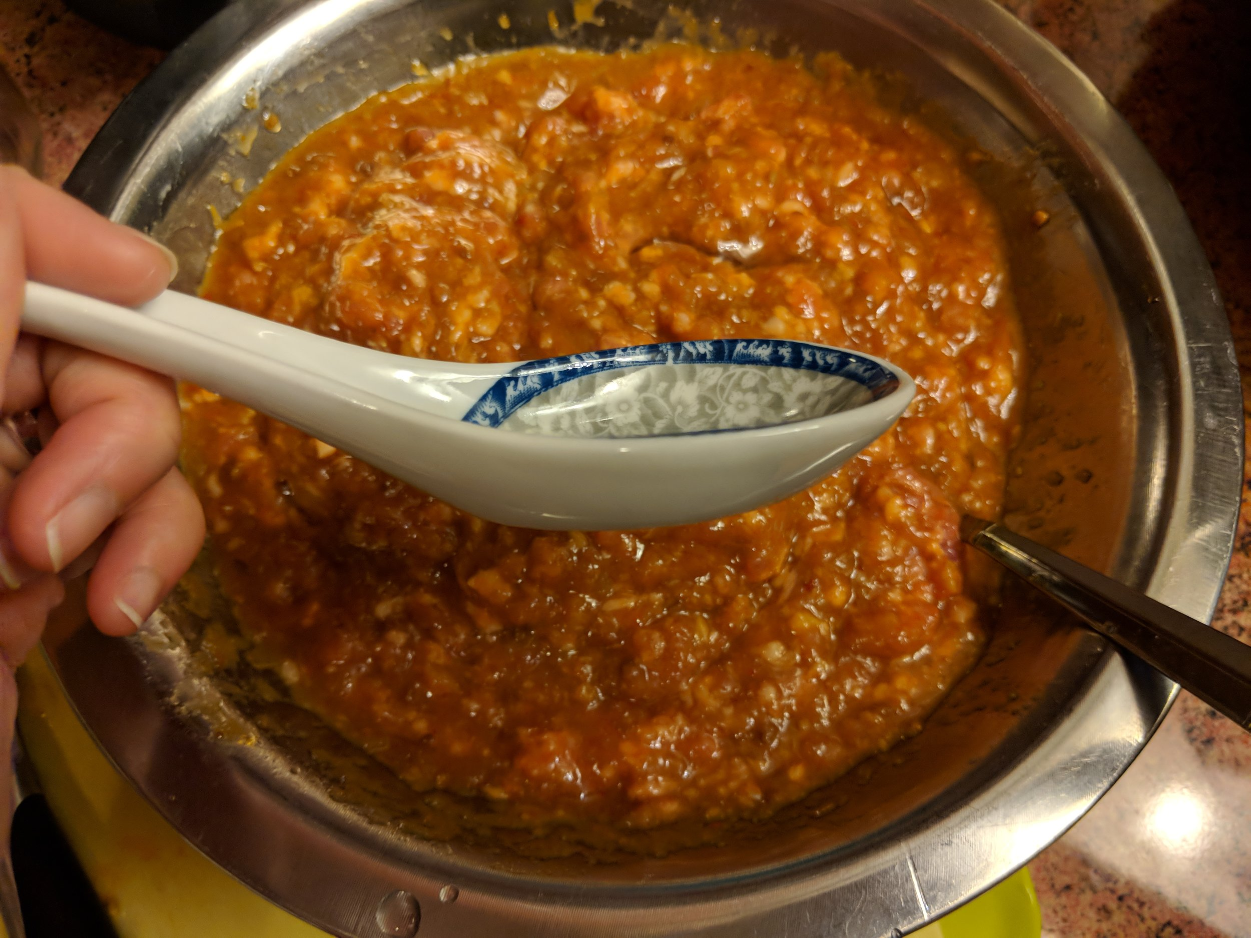 "Sample depth of soup spoon. This type of spoon gives your Rieu a ""meatball"" type of mold and shape later so it won't disperse into bits in the soup."