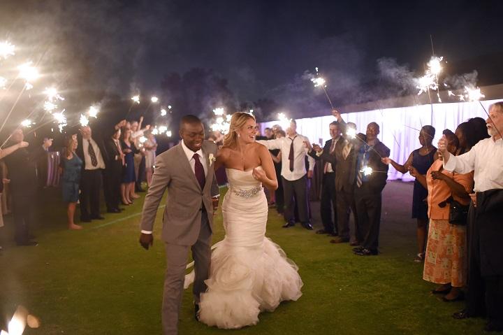 four_seasons_Dallas_Purple_outdoor_wedding_swank_soiree_wedding_planner_exit_sparklers.jpg
