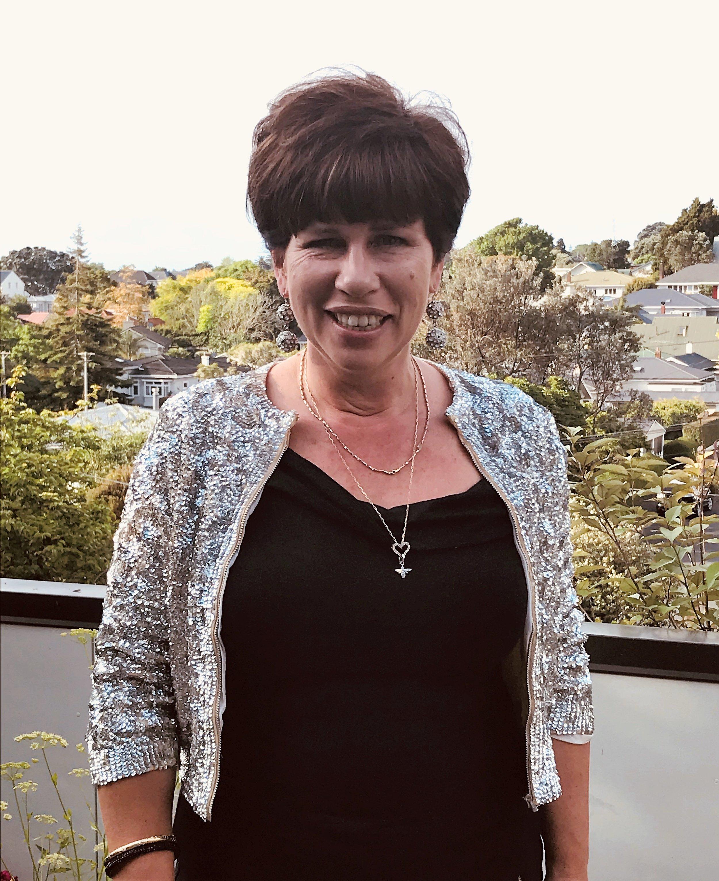 VALERIA BURROWS, DIRECTOR