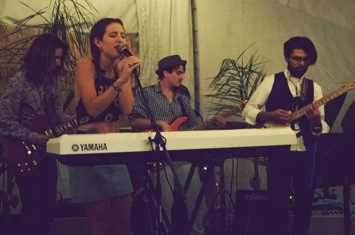 Hassan Dahik and Benjamin Jay (far right) preforming for Michelle Leclercq in 2017.