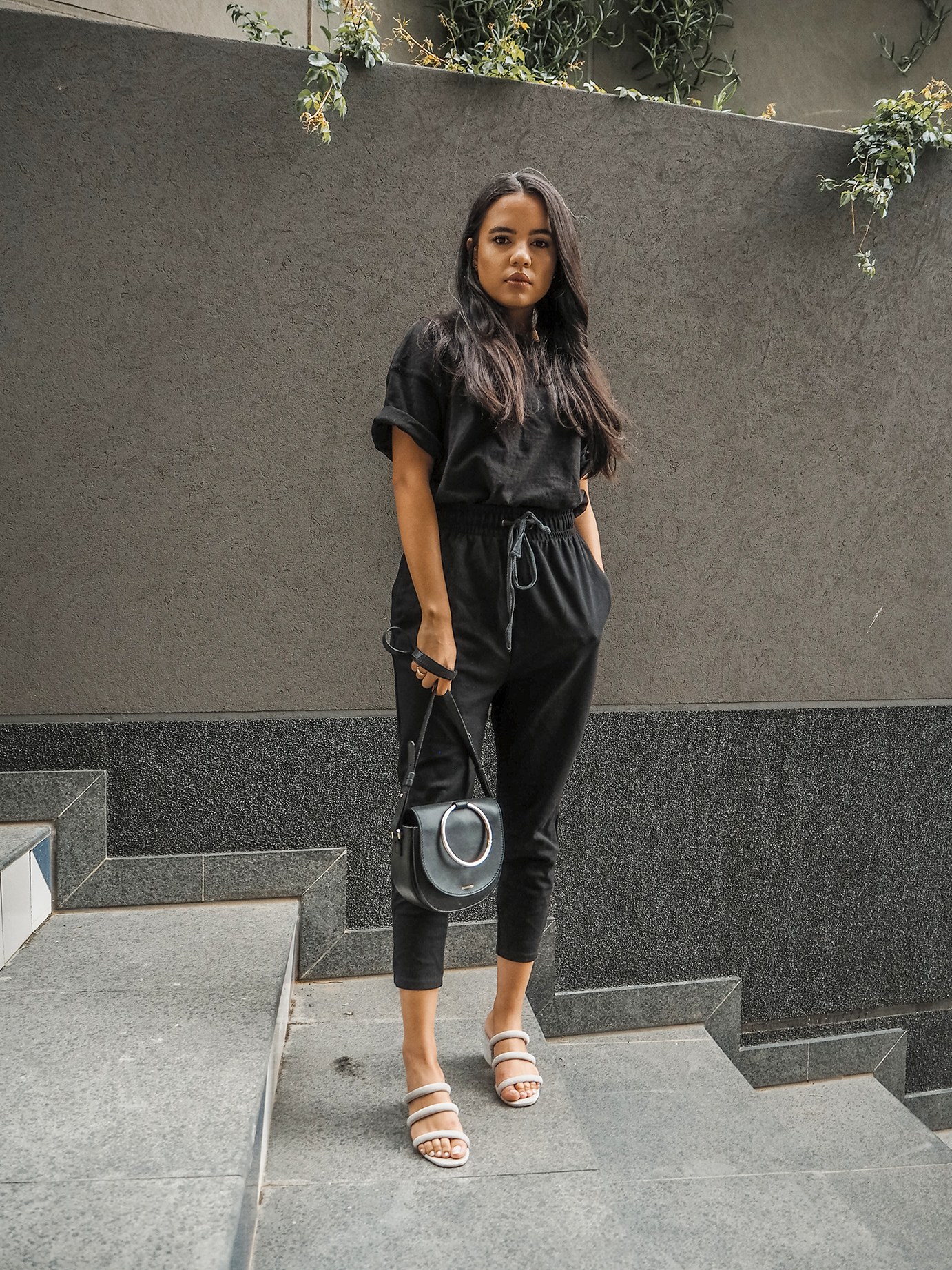 """Basic Black - Relaxed pieces are applicable for those """"I have nothing to wear!"""" days. I have lived in these drop crotch, athleisure trousers for almost 3 years, and they're still going strong. Dressed with a plain black t-shirt and a trendy leather bag, your outfit immediately takes form to luxury lounge wear.To lift the luxury lounge wear, pair with a body suit and cute heels, for those last minute night out plans.Shop similar items below."""