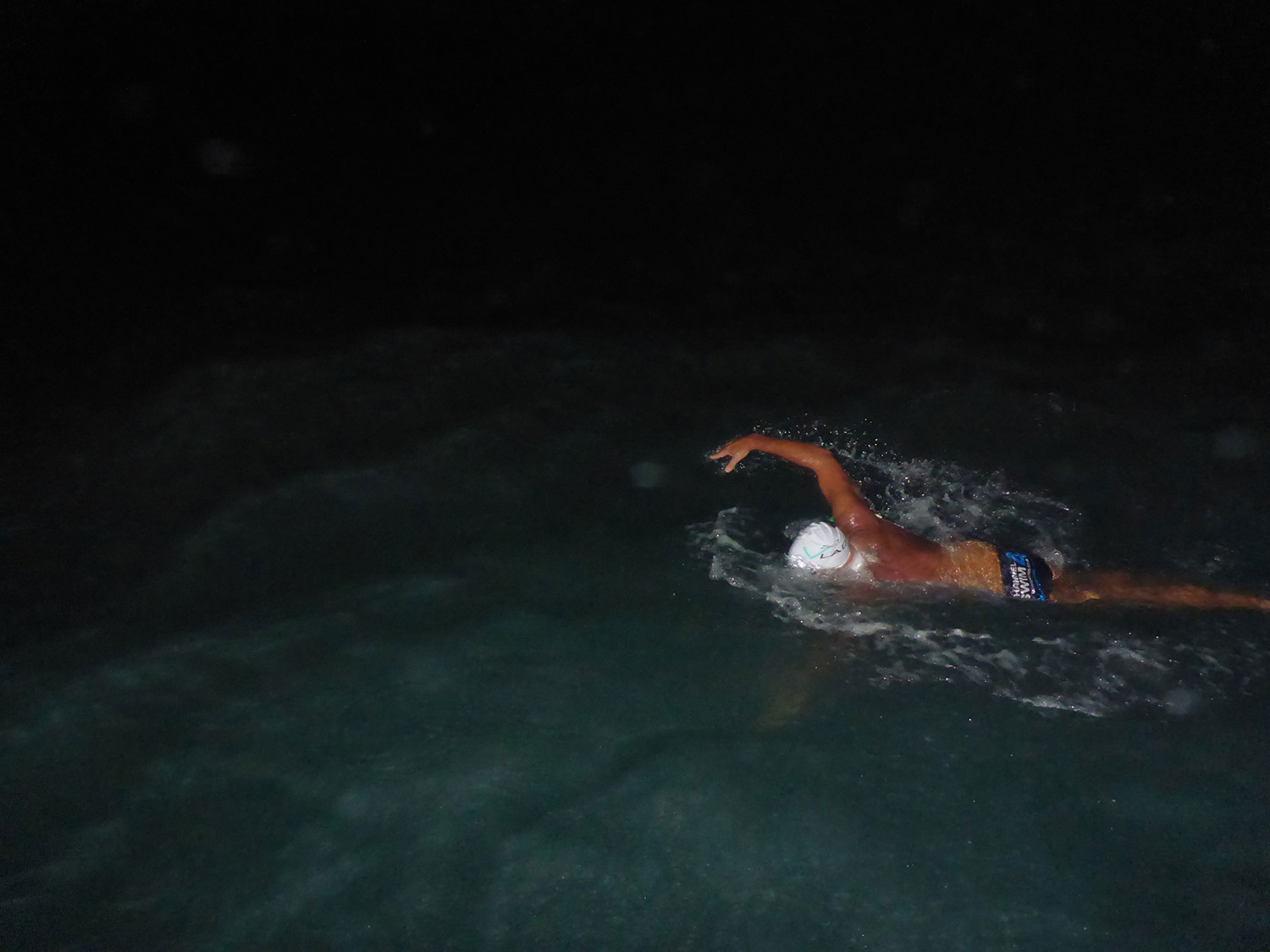Dean swimming at night