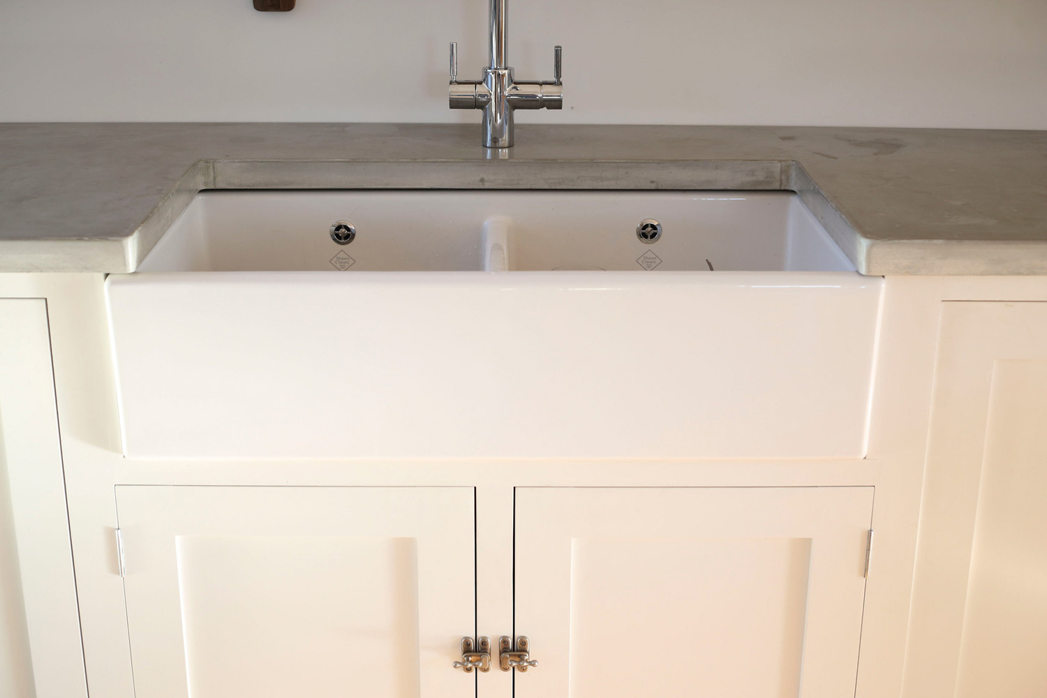 Cast and polished concrete worktops, surrounding Belfast sink, Tinney and Co