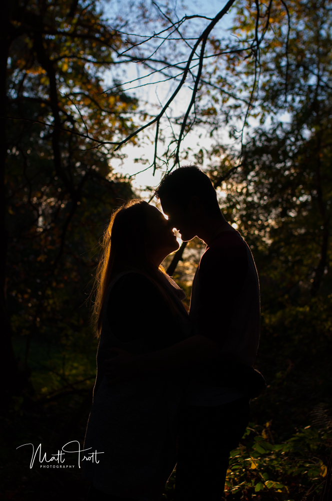Backlit couple by the sun on an engagment shoot in ashenbank wood