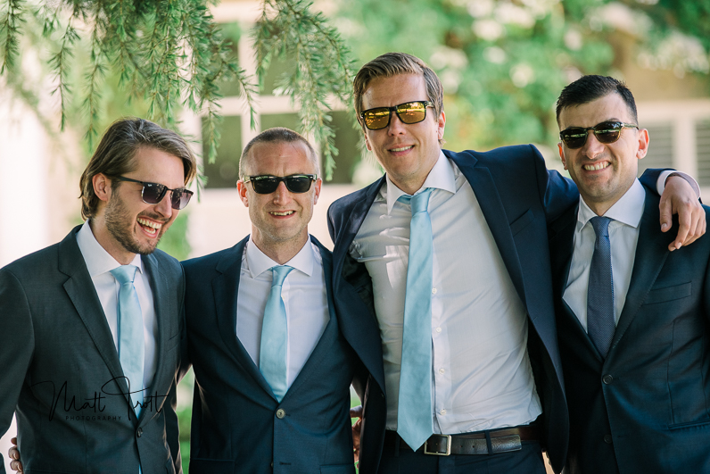 Groomsmen laughing with sunglasses on