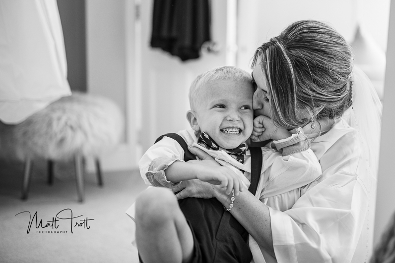 Bride tickling son during prep at her wedding at northbrook park