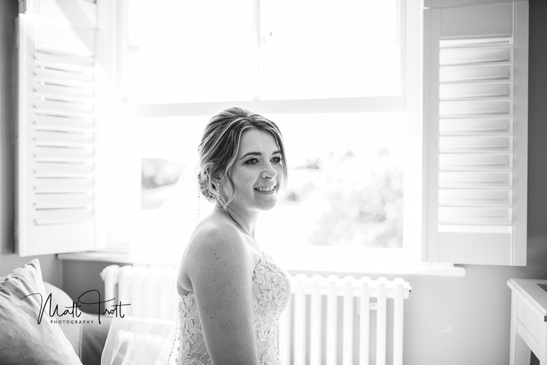 Natural light bride in front of the window