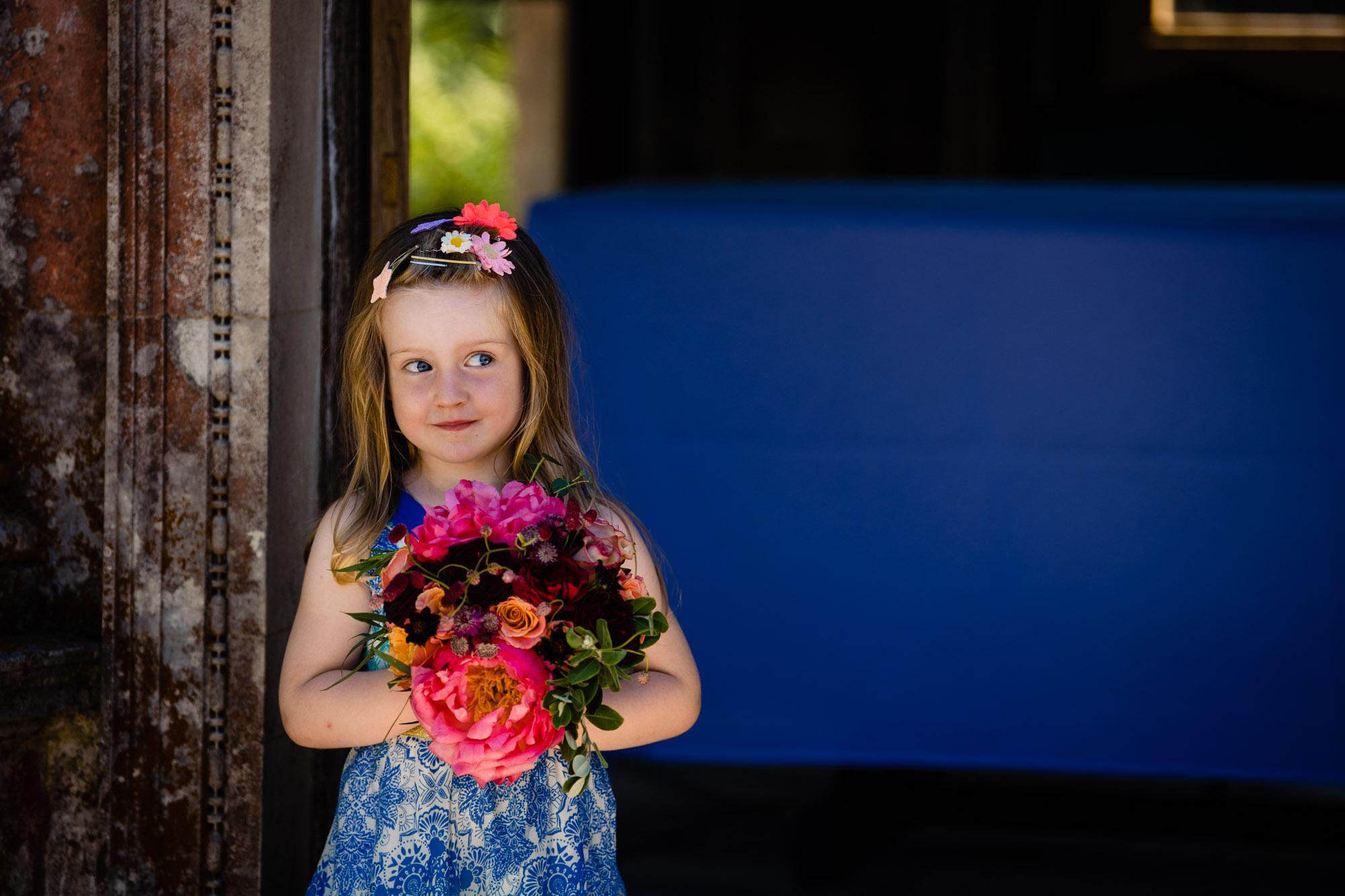 Cheeky girl posing for Kent family photographer