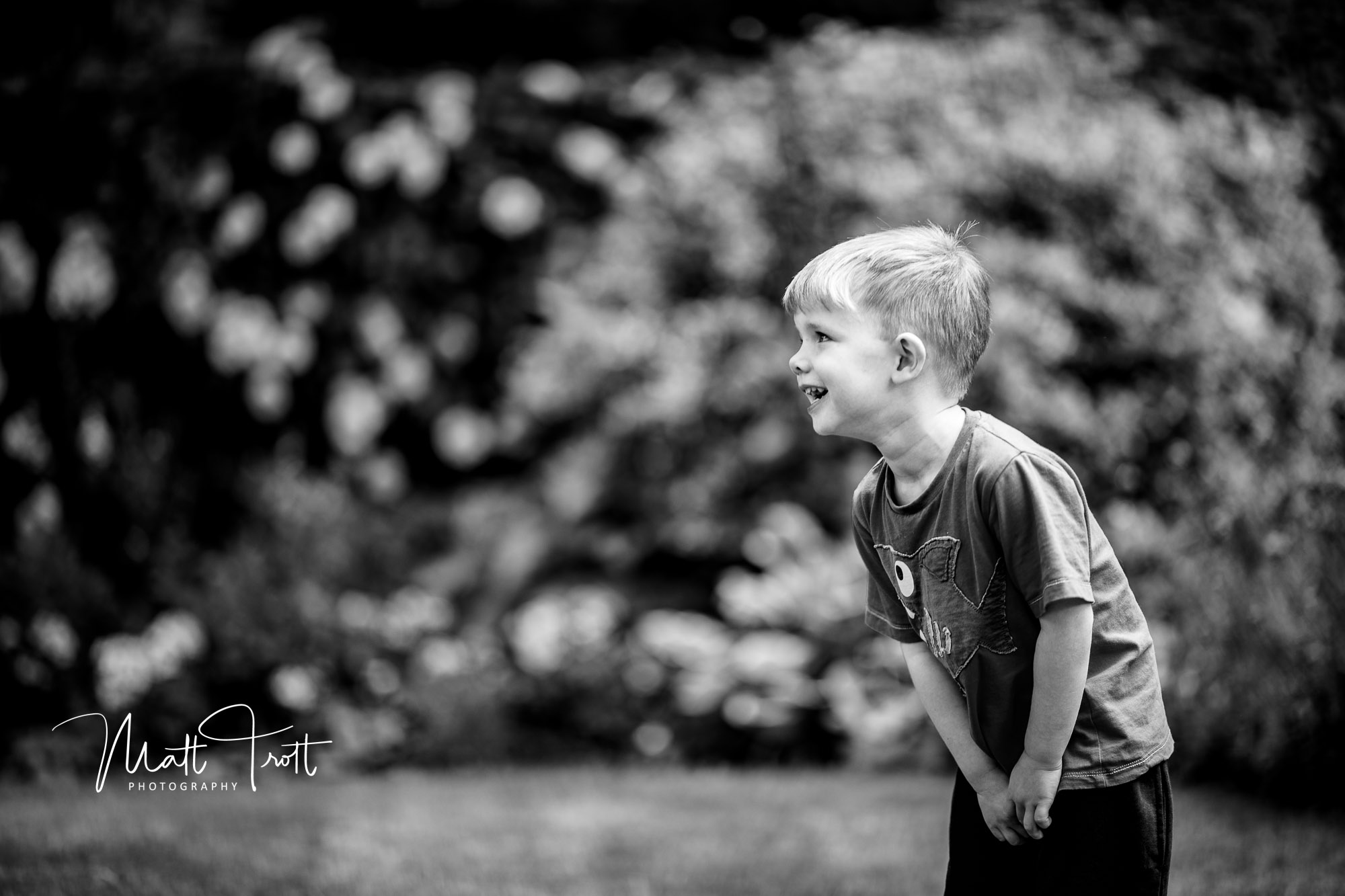 Young boy playing football kent family photography
