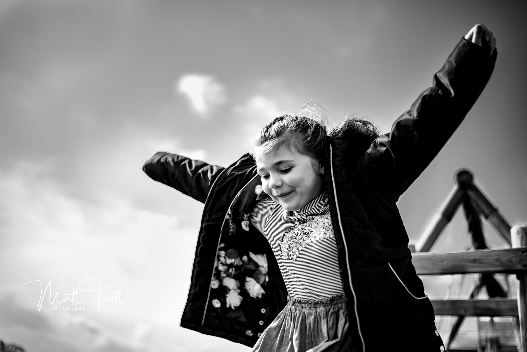 Girl jumping in the air with arms wide open in Maistone