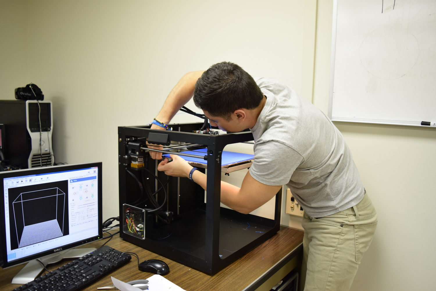 Solid Dynamics' Personnel Repairing a Printer after an In-Process Failure