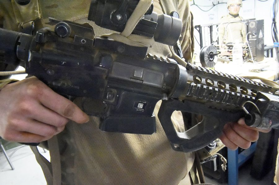 An M4 assault rifle with 3D-printed magazine well and foregrip made with the ARDEC R-FAB unit