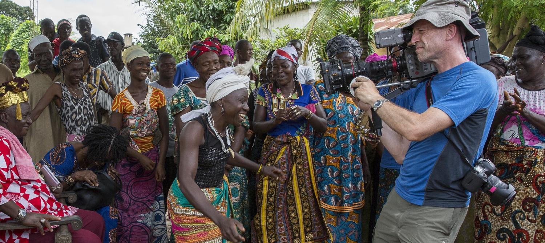 Steven Gray DOP, shooting on location in Sierra Leone for Documentary Group series on viruses. Sound and stills Tamara Stubbs