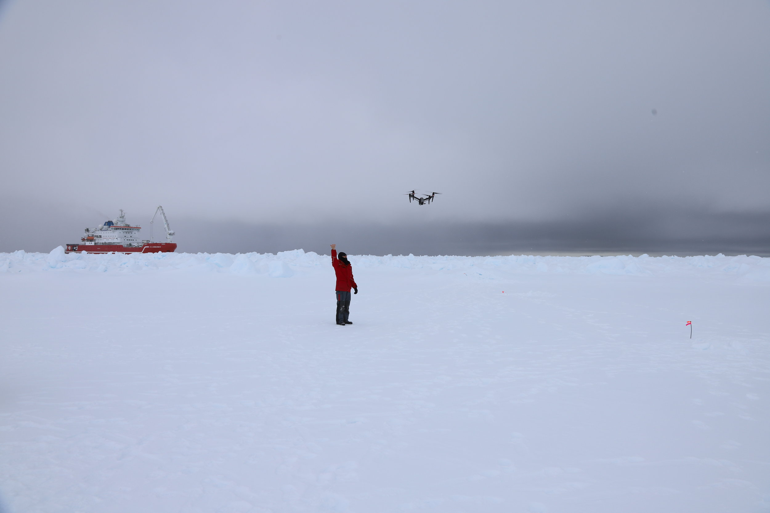 Possibly the first 'drone delivery' in Antarctica as I deliver a memory stick and phantom 4 rotor with an Inspire 2 to the off ship party from the bow of the ship.  Photo credit: Dr. Claire Grogan, Expedition Doctor