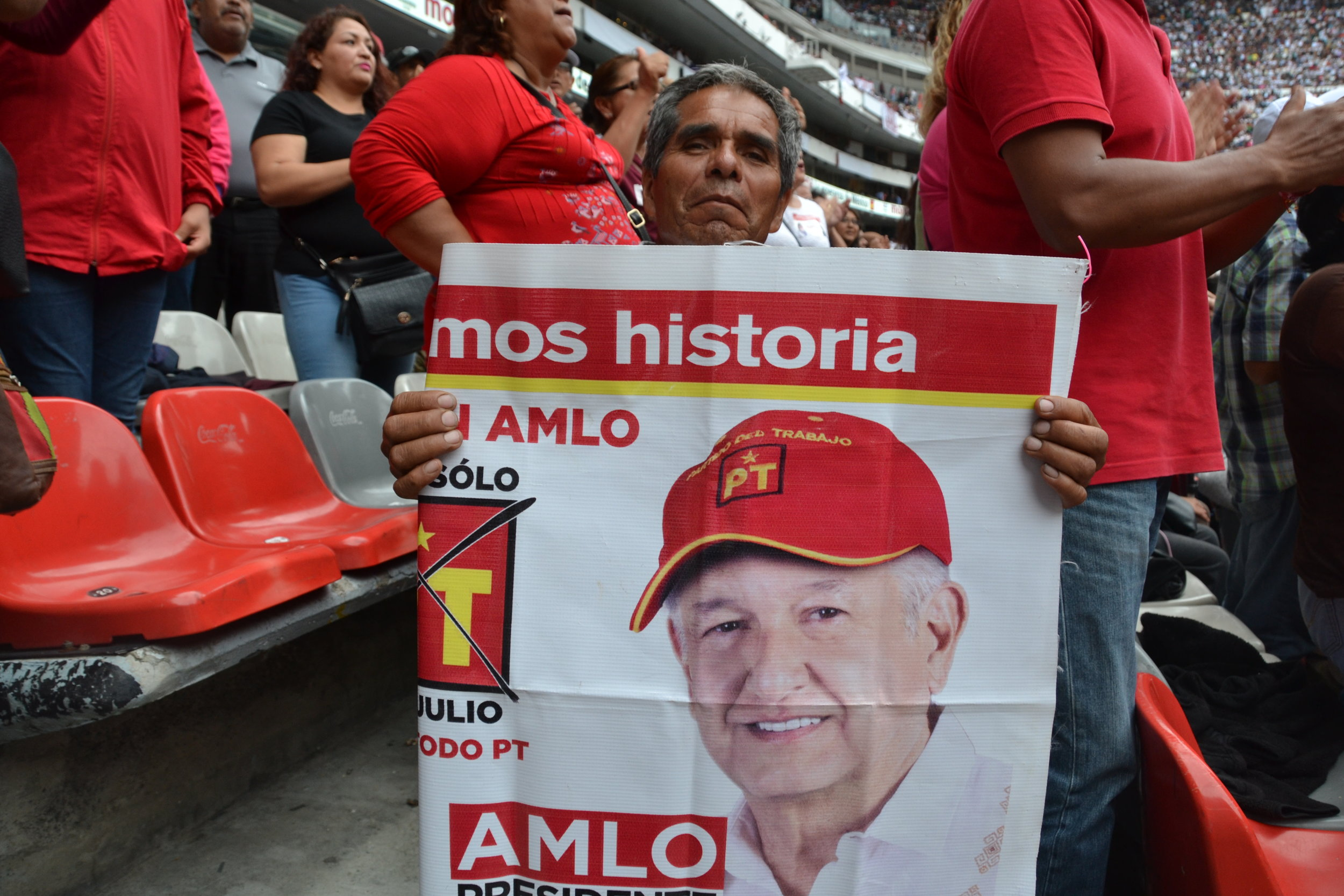 Javier Perez-Ramirez, 65, holds a poster of Mexican presidential candidate Andres Manuel Lopez Obrador.  Photo: Oscar Lopez.