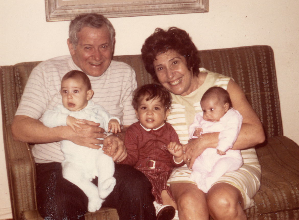 With my Grandmother Pauline and Grandfather Nathan.  I'm the baby in pink in Pauline's arms.