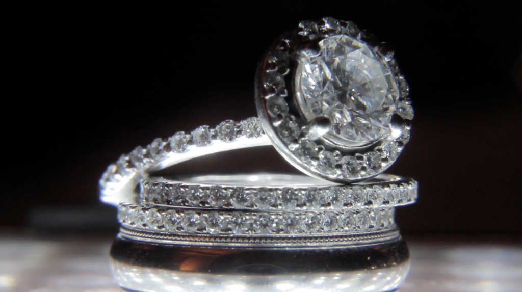 Wedding Band Set of Bride's Engagement ring and band plus Groom's wedding ring.