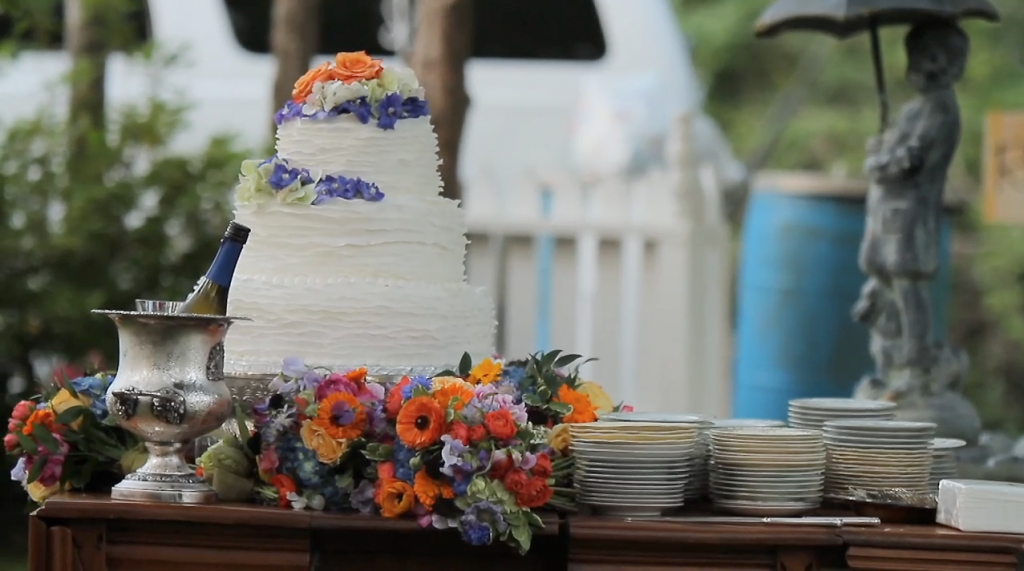 ruffle wedding cake with bridesmaids bouquets wedding pic 01