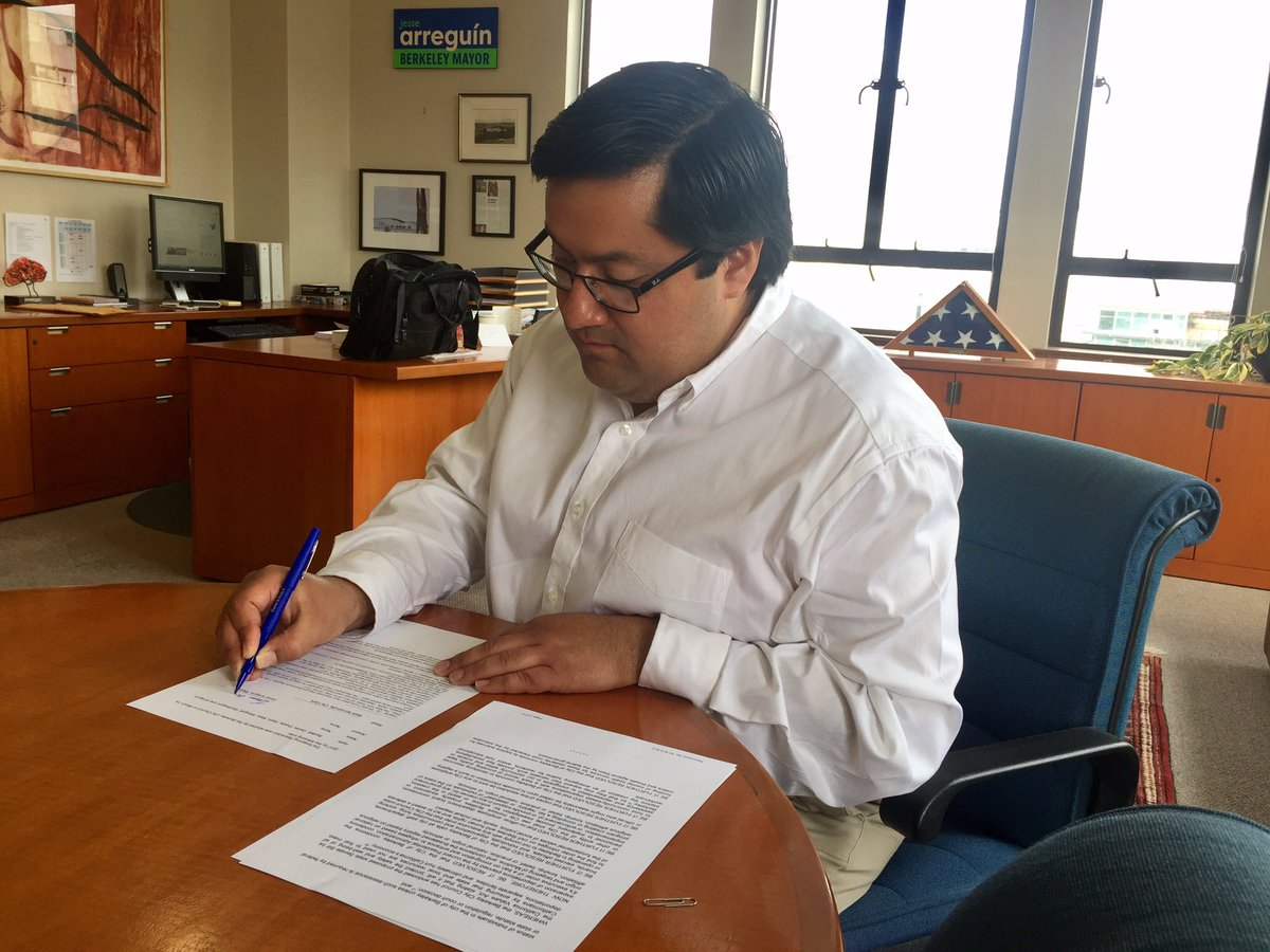 The Mayor signs into law our City's divestment from companies involved in Trump's border wall.