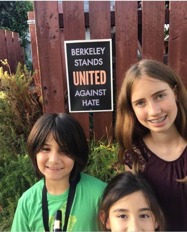 children_putting _up_signs.jpg
