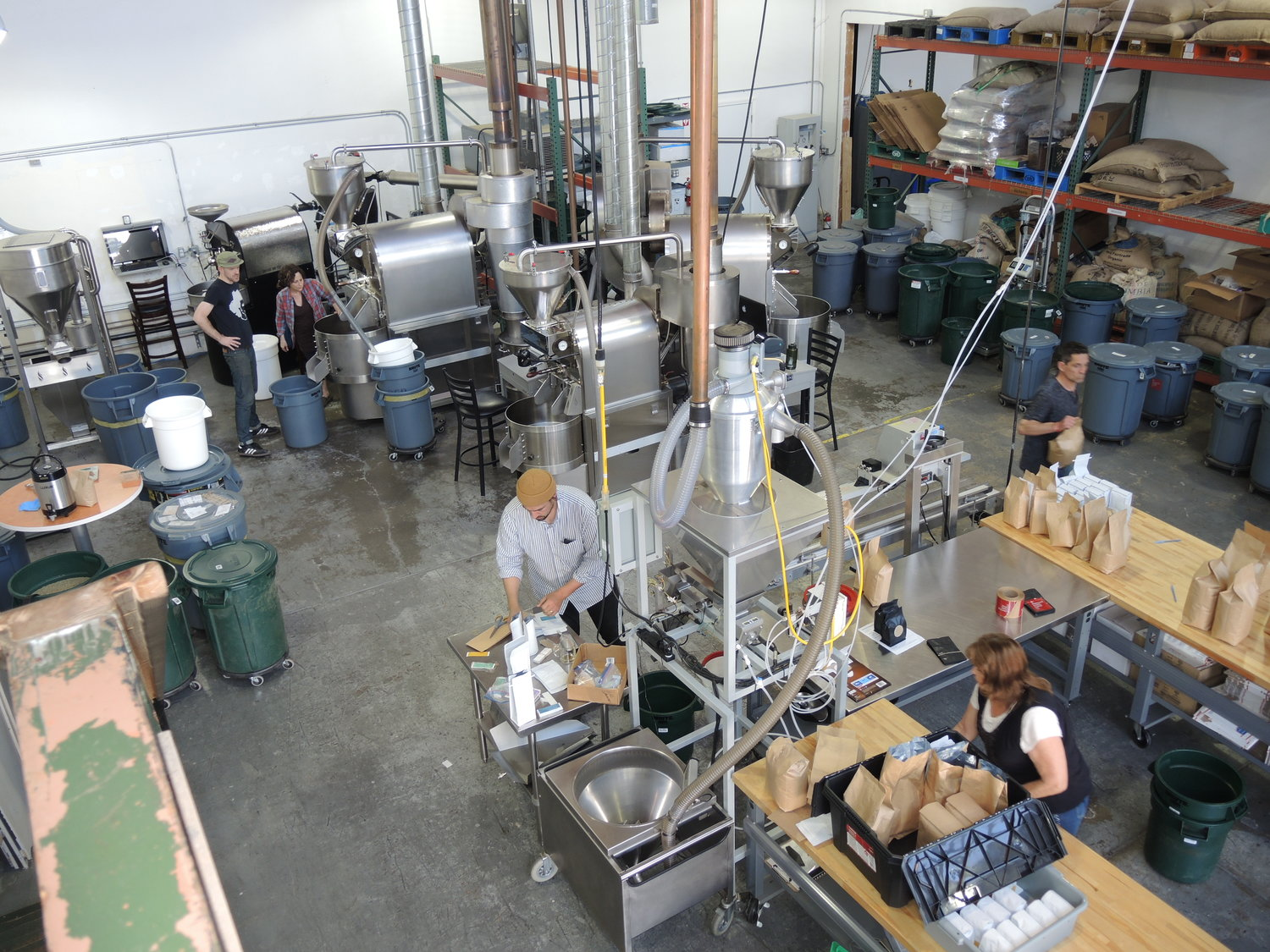 Workers at Bay Area CoRoasters, a collaborative coffee roasting space in West Berkeley.