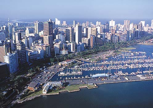 Durban is a bustling city of over half a million people. With a wealth of beautiful beaches, the city is a tourist attraction. The photo above shows the Durban Marina. Beyond, the beach stretches for miles up the North Coast of Kwa-Zulu Natal, now called the Dolphin Coast.  We used to like going to the beaches at Salt Rock, Shaka's Rock, Umhlanga, and Umhloti.