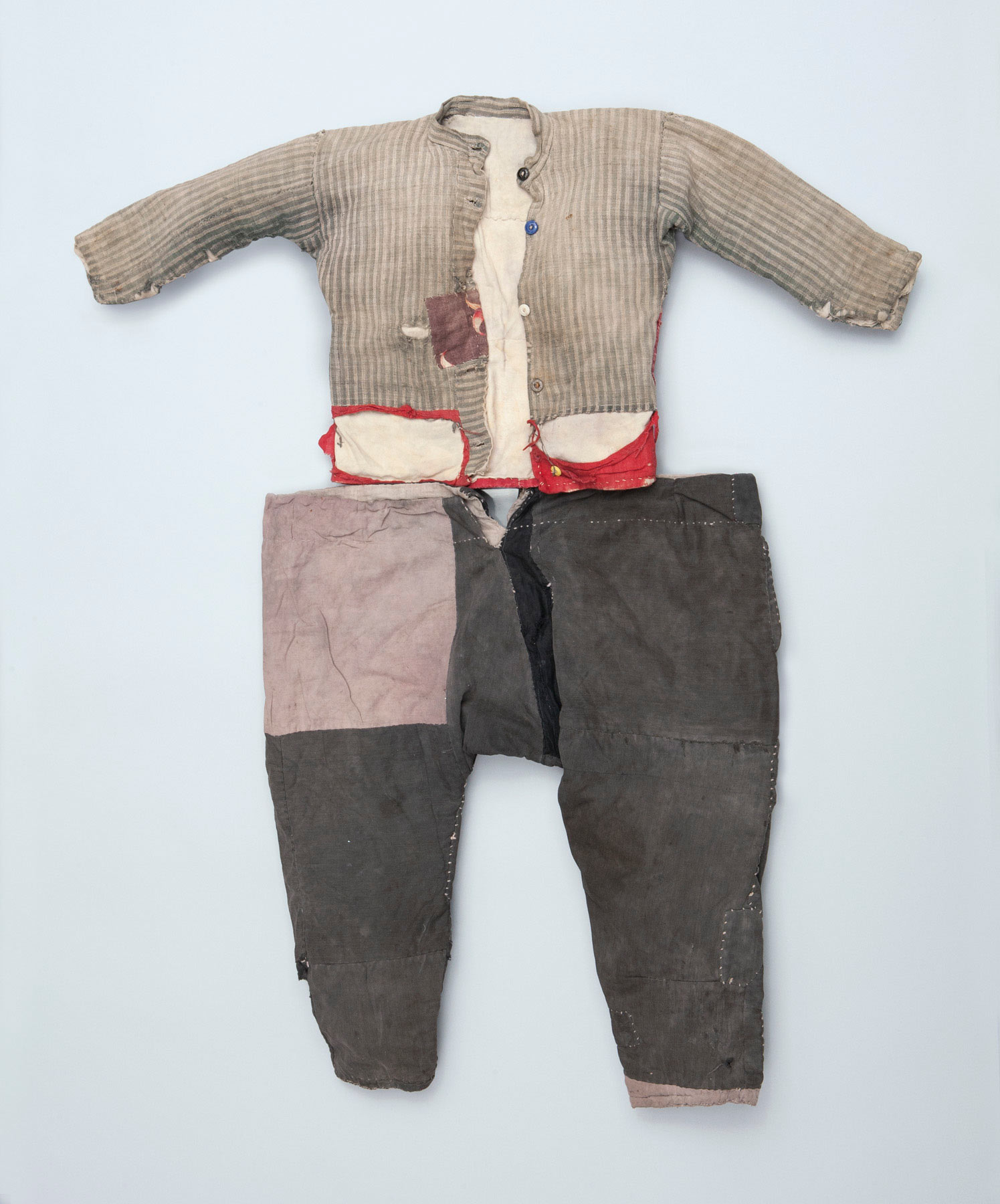 "Armenian Boy's Costume. These pants, shirt, and shoes were recovered from the body of a deceased Armenian child found in the Syrian desert by American missionary Helen Gutterson while searching for survivors. Upon presenting these to the Armenian Museum in 1973, she urged ""keep these for future generations, lest people forget."""