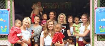 volunteer with kids cr.jpg