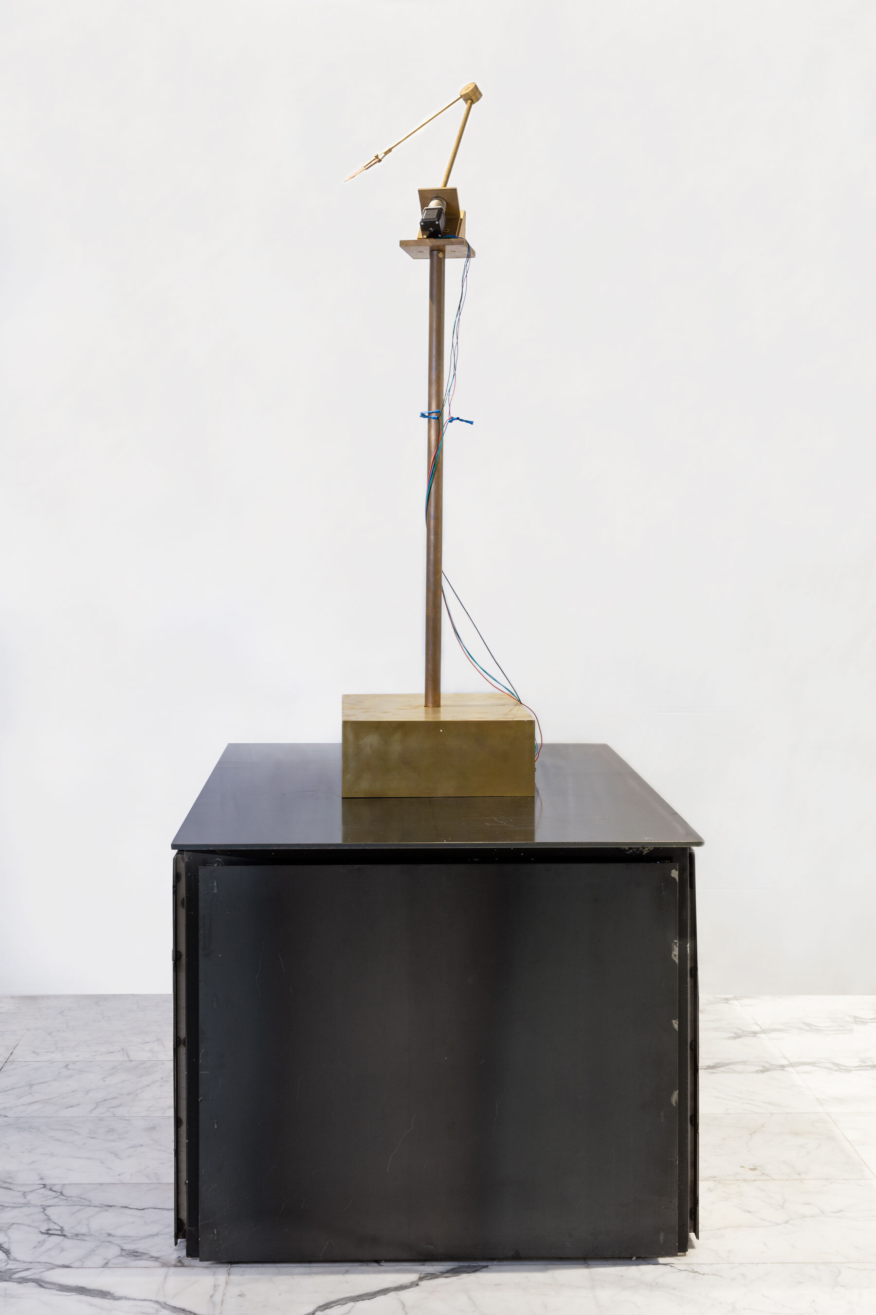 Atlas   Brass, rotation motor, Neolithic Dalton point, electronics, wood    120 x 40 x 40 cm    2019