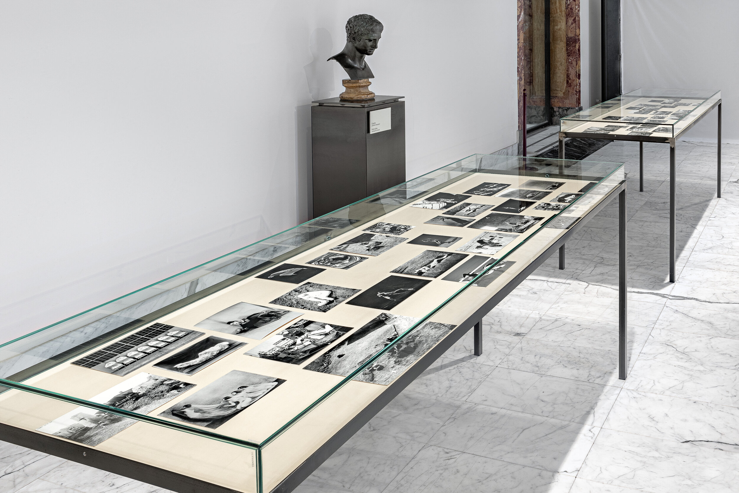 Attitude 1 and Attitude 2   Steel and glass vitrine, black and white photographs, fabric    100 x 210 x 75 cm    2019