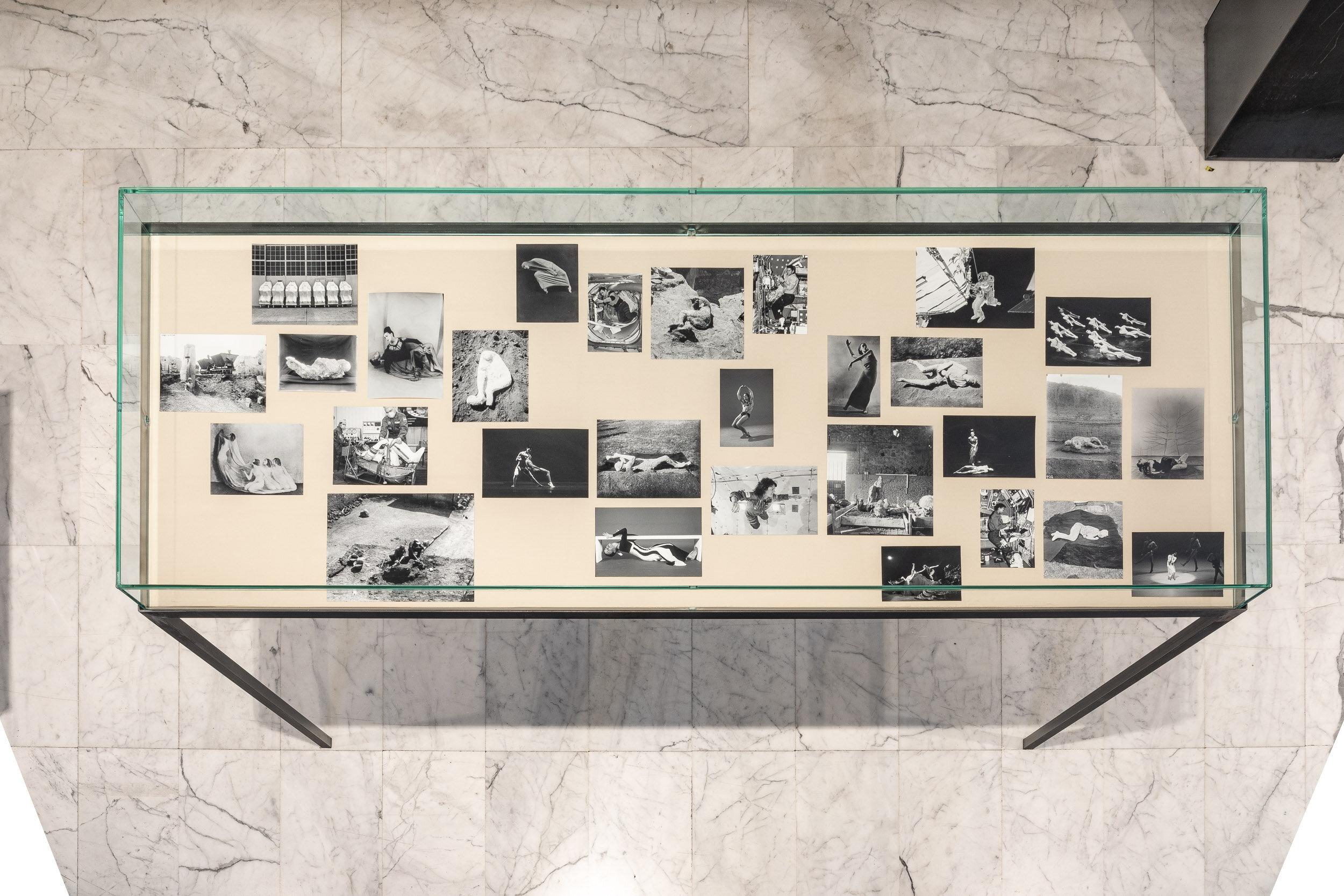 Attitude 2   Steel and glass vitrine, black and white photographs, fabric    100 x 210 x 75 cm    2019