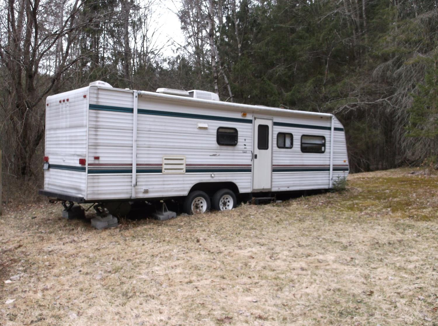 19,900 - 2 AcresNice Location With Driveway & Electric2 Camping Trailers Included