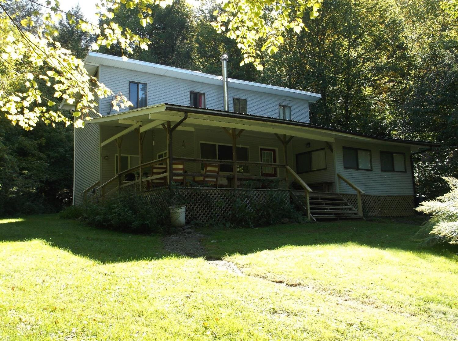 119,900 - 7 Bedrooms, 1 Bath12.35 AcresPond, Adjoins State Land