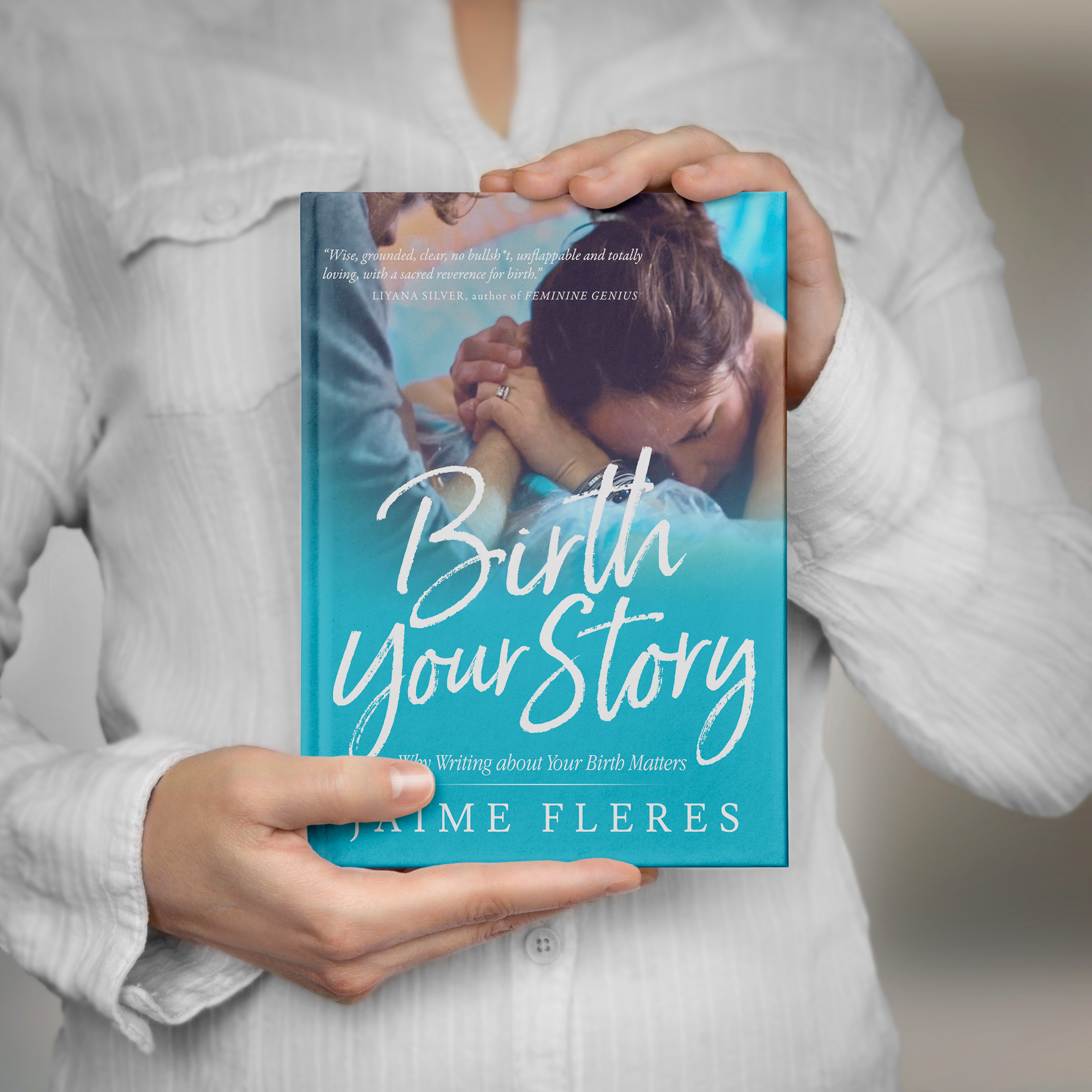 Woman holding Birth Your Story book by Jaime Fleres