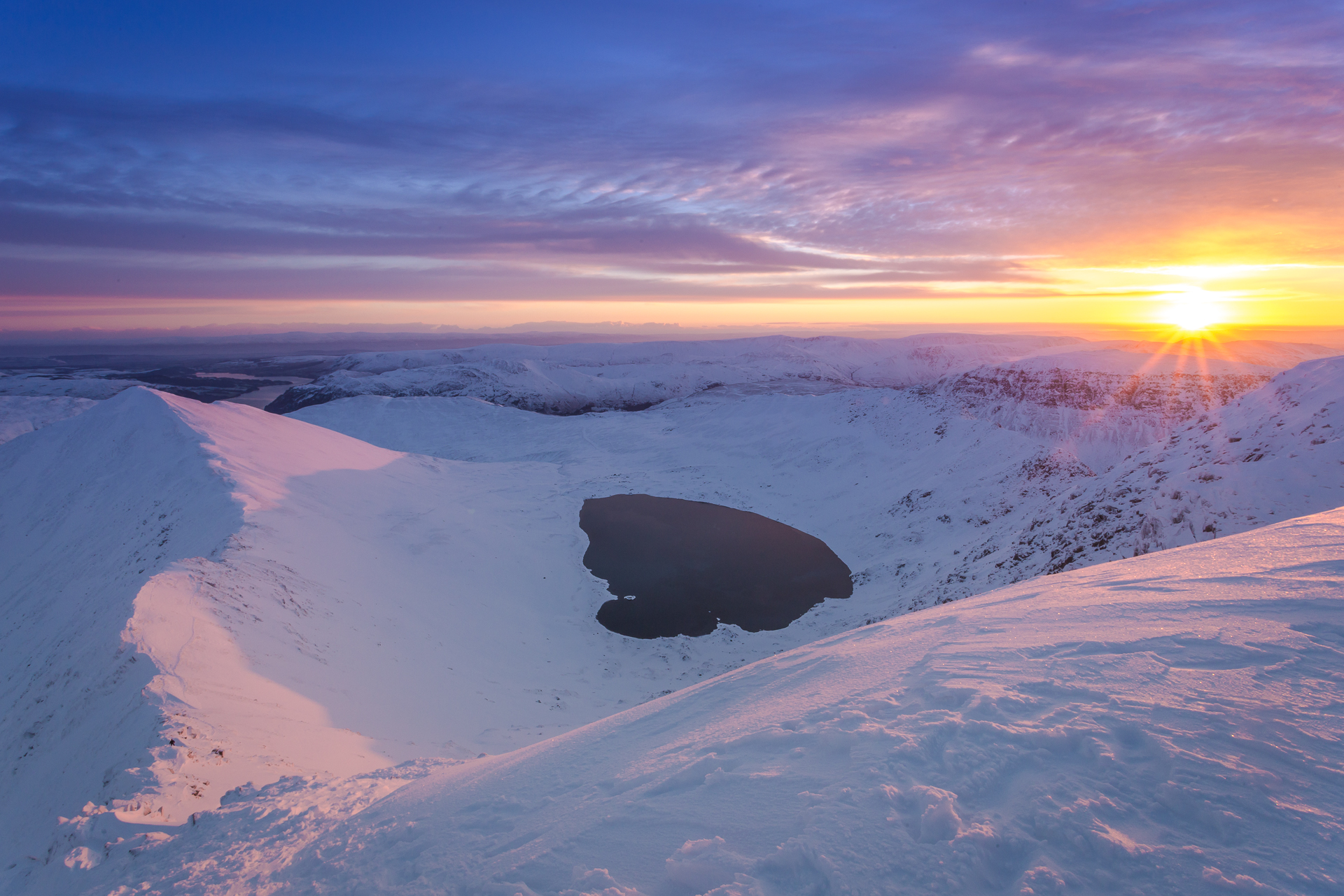 A strong shadow was cast on Swirral Edge by the rising sun