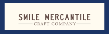 smile mercantile with blue outline.PNG