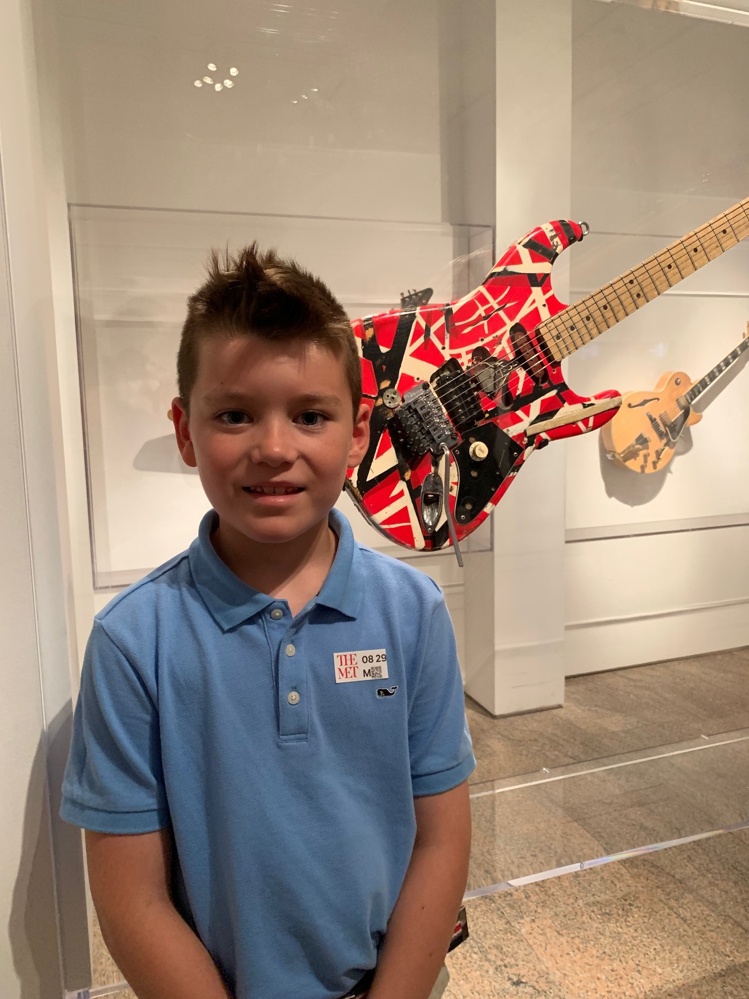 the boy with Eddie's guitar.jpg